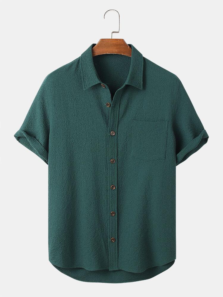 Seersucker arrugado de color sólido para hombre, manga corta, dobladillo alto-bajo Camisa