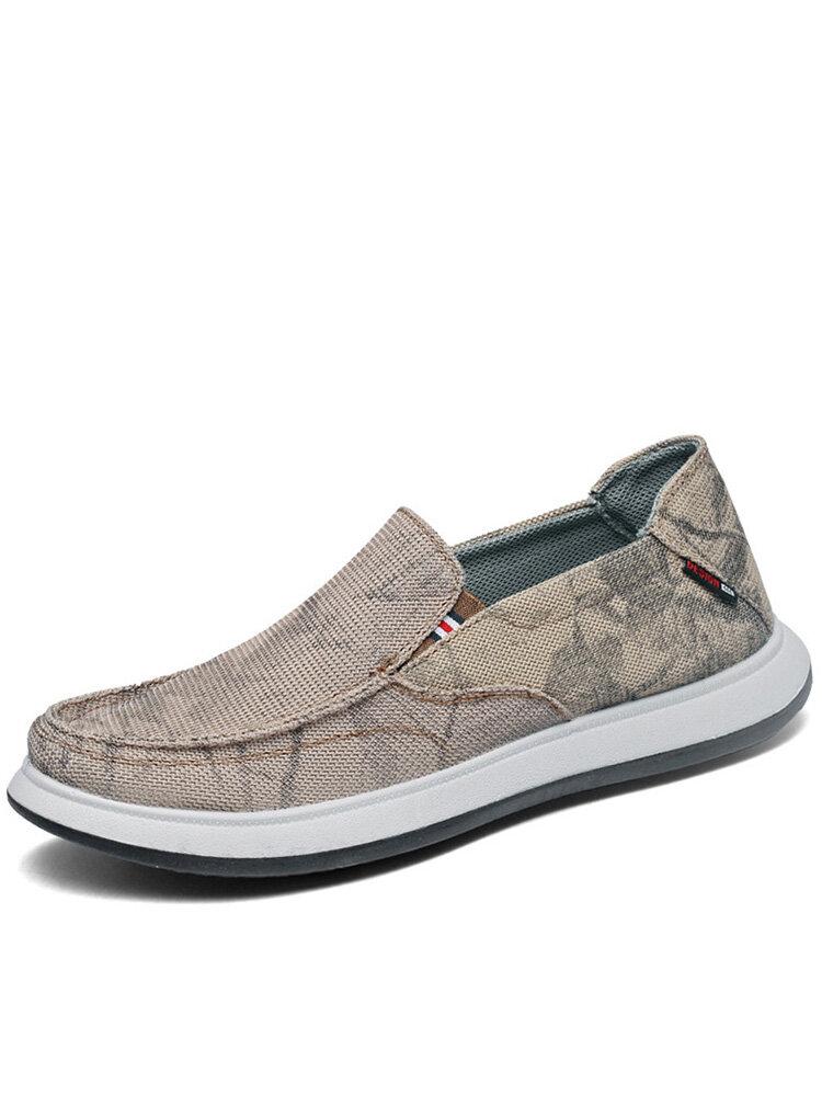 靴の男性のキャンバスの通気性の非スリップの偶然のスリップ