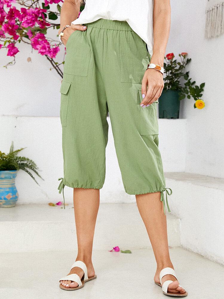 Pantalon court en coton à taille élastique avec cordon de serrage et poches de couleur unie