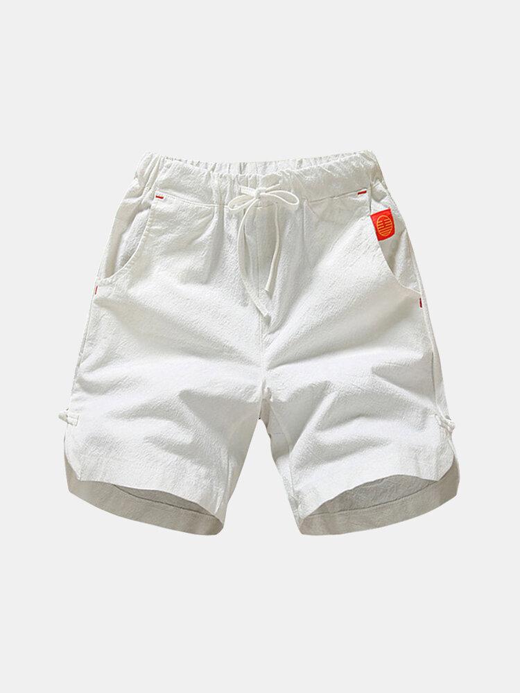 Short de bain décontracté confortable à cordon de serrage en couleur pure en coton lin pour homme