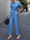 Solid Color Short Roll Sleeve Knotted Back Jumpsuit With Pocket - Blue