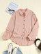 Blusa con cuello alto y botones de manga larga en color liso vendimia - Rosado
