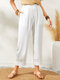 Solid Color Hollow-out Patchwork Elastic Waist Pocket Casual Pants - White