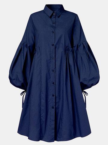 Robe bouffante boutonnée de couleur unie