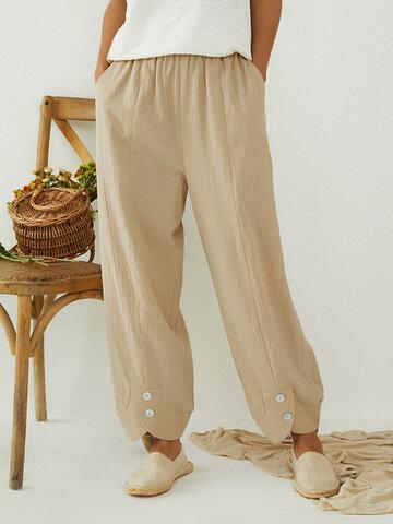 जेब के साथ ठोस रंग लोचदार कमर बटन ढीला पैंट