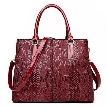 Элегантная глянцевая лакированная кожаная сумочка