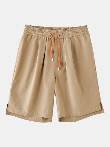 Shorts divididos con cordón de color liso