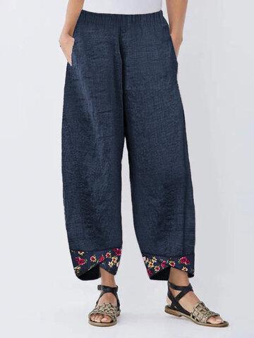 Pantalon patchwork à fleurs irrégulières