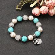 JASSY® böhmisches elastisches Perlenarmband Türkisperle Naturstein CND Friedenssymbol Geschenk