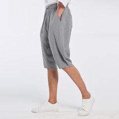Shorts décontractés respirants d'été en coton et lin en couleur pure à genou-longueur avec cordon de serrage pour homme